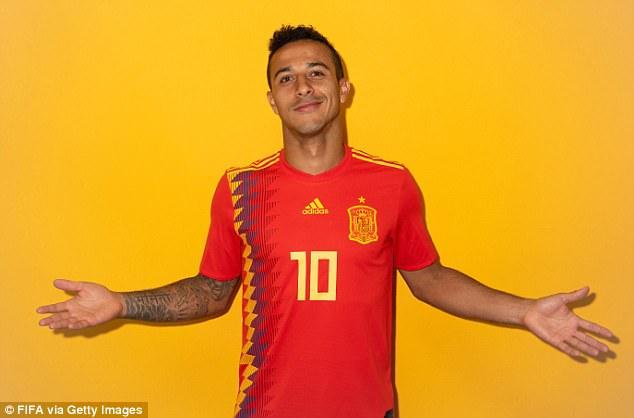 Thiago Alcantara, brimming with confidence, shrugs as he smiles cheekily at the camera