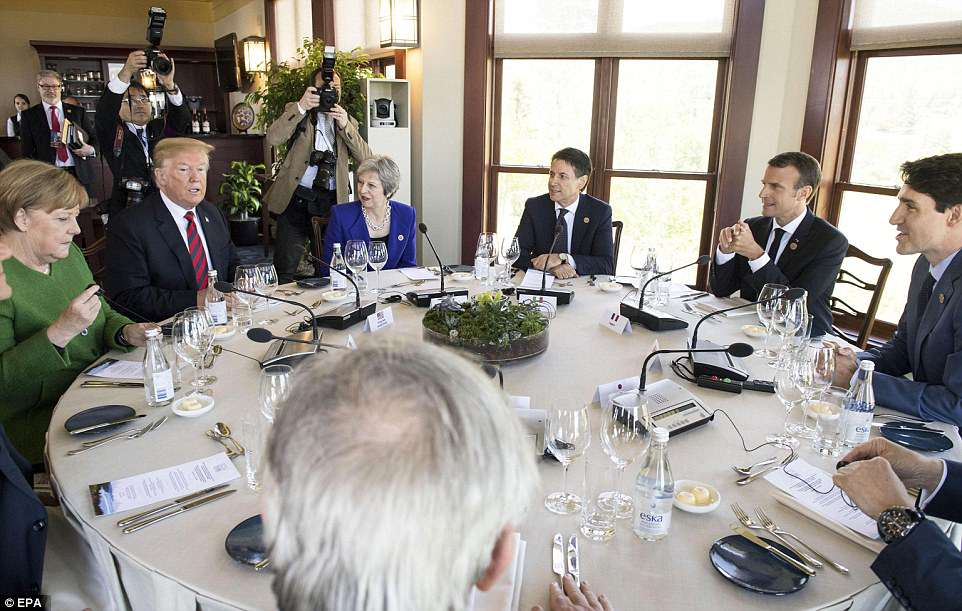Happy family meal: Lunch, a distinctly non-Trumpian menu which included Arctic char perfumed with Labrador tea, saw him seated between Germany's Angela Merkel and Britain's Theresa May. To the right of may is Italian Prime Minister Giuseppe Conte, French president Emmanuel Macron and Canadian prime minister Justin Trudeau