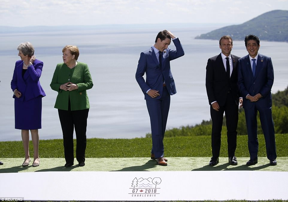 Get ready for my close-up: Justin Trudeau was at the center of the family group as the host and was waiting for Trump while (from left) Theresa May, Angela Merkel, Emmanuel Macron and Shinzo Abe prepared for the family photo