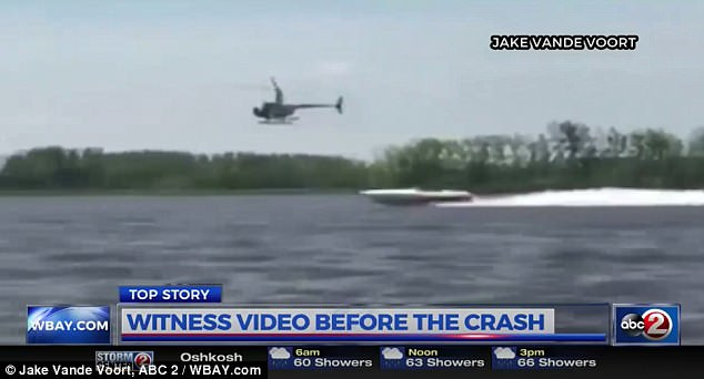 The helicopter, above, was filmed above a boat just 30 minutes before the crash