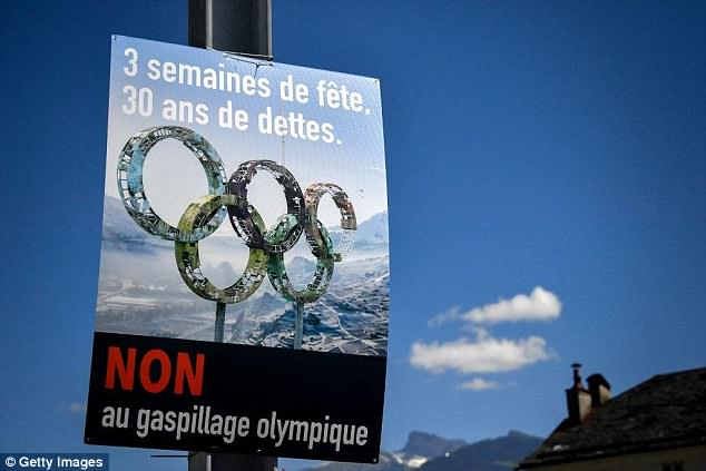 An electoral placard against Sion 2026 Winter Olympics bid hangs in the streets ofCollombey