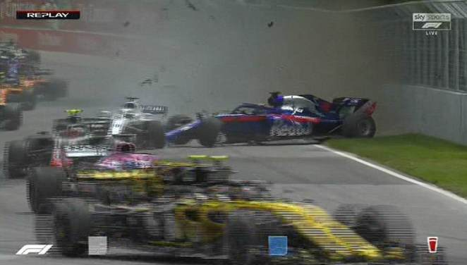 The two vehicles tangled immediately and sent both hurling from the track out of control