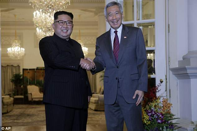 Kim meets with Singapore's Prime Minister Lee Hsien Loong at the Istana on Sunday
