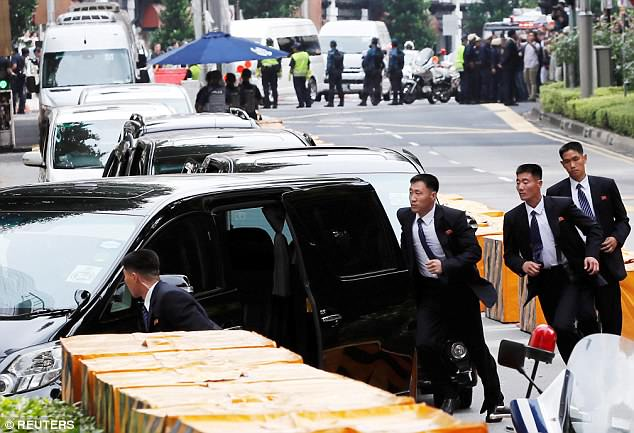 His suit-clad security detail were spotted running alongside his black limousine shortly after the North Korean leader touched down at Changi Airport on Sunday