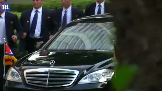 The car had tinted windows and two large North Korean flags flying from the front