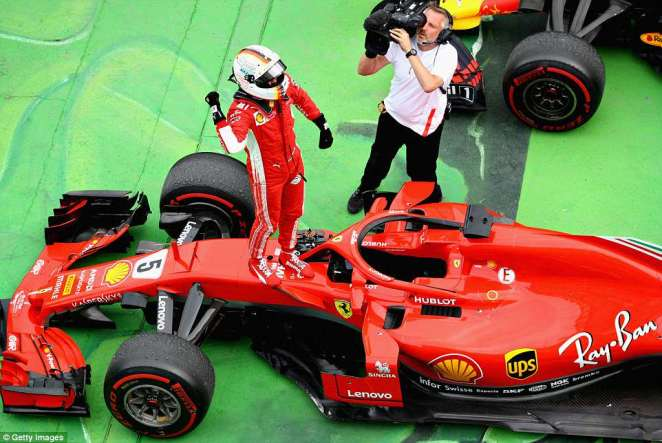 The German stands on top of his Ferrari after claiming the team's first victory in Canada since Michael Schumacher in 2004