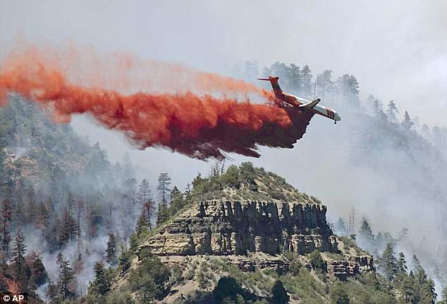 Low humidity and high winds have left firefighters bracing for the fire to spread and the weather was expected to be dry and windy on Sunday