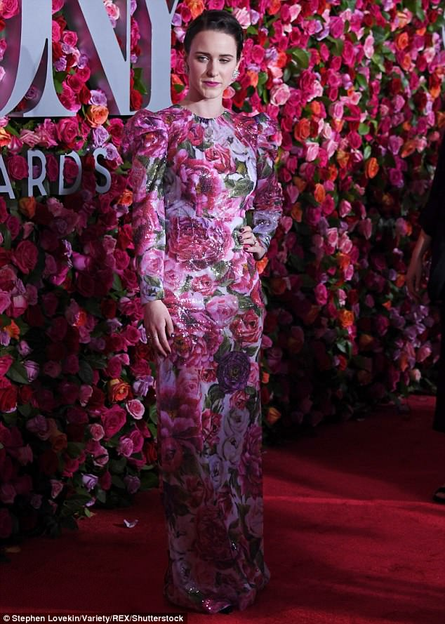 Garden of Eden: The House Of Cards standout almost entirely blended in with the red carpet's lush backdrop of pink, red and purple blooms