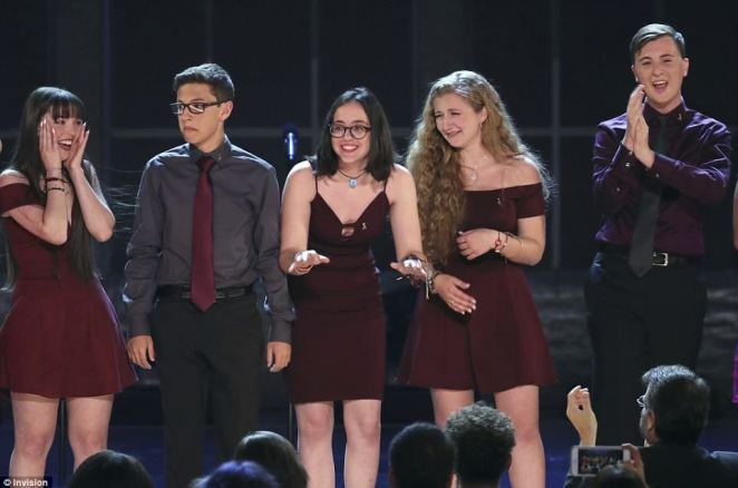 The students react after performing Seasons of Love from the musical RENT at Radio City Music Hall