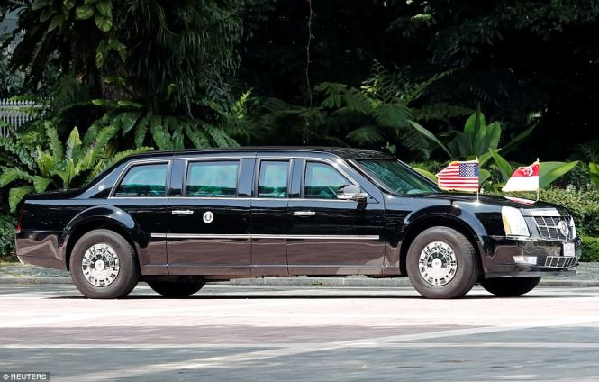 The motorcade transporting U.S. President Donald Trump leaves the Istana, or presidential palace, in Singapore on Monday afternoon