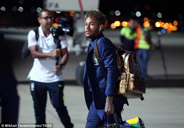 Brazil star Neymar showed off his £700 gold bag emblazoned with family faces on Sunday