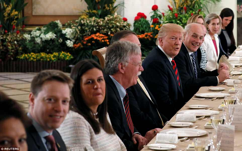 U.S. President Donald Trump and his delegation have lunch with Singapore's Prime Minister Lee Hsien Loong and officials at the Istana in Singapore. To the president's left is White House Chief of Staff John Kelly. And to his right is Secretary of State Mike Pompeo. Also at the table: White House Press Secretary Sarah Sanders, National Security Advisor John Bolton and Senior Policy Adviser Stephen Miller