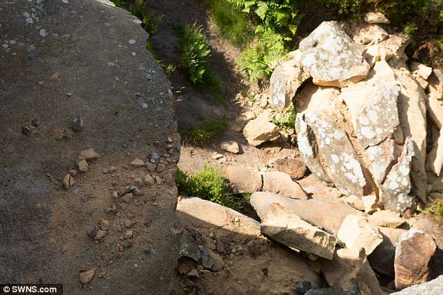 Rubble gathered at the bottom of the site after five youths toppled the rock from its balancing point on the York Moors