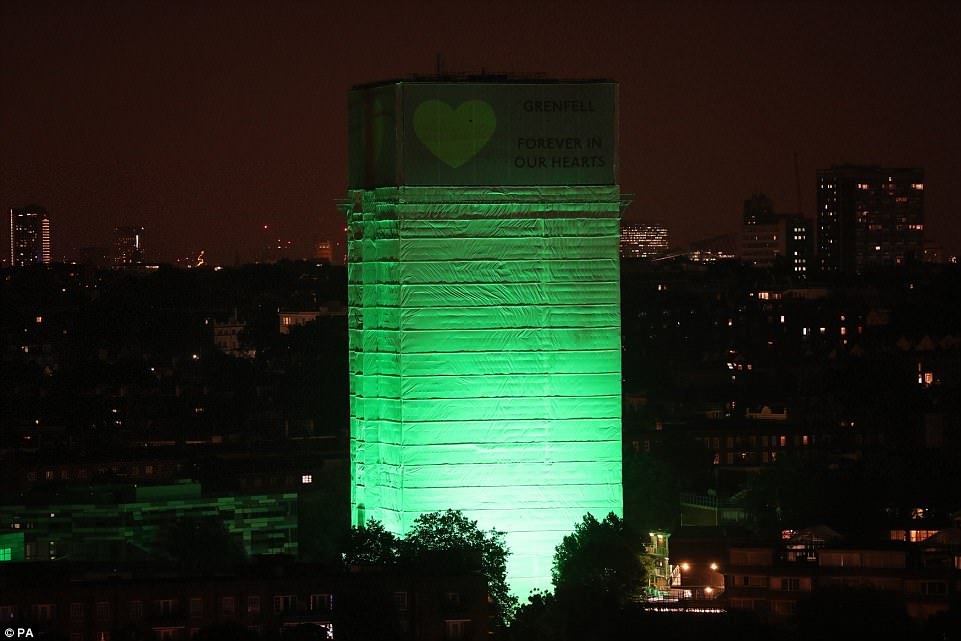 Grenfell Tower in west London is illuminated in green to mark a year since the moment the devastating fire took hold, claiming 72 lives