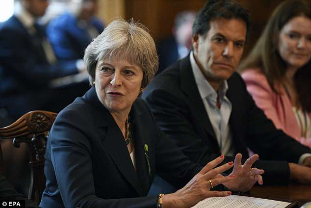 The Prime Minister (pictured at a business event in Downing Street yesterday) is attempting to defuse tensions with Tory Remainers by tabling a compromise amendment to the flagship EU Withdrawal Bill on a 'meaningful vote' for Parliament