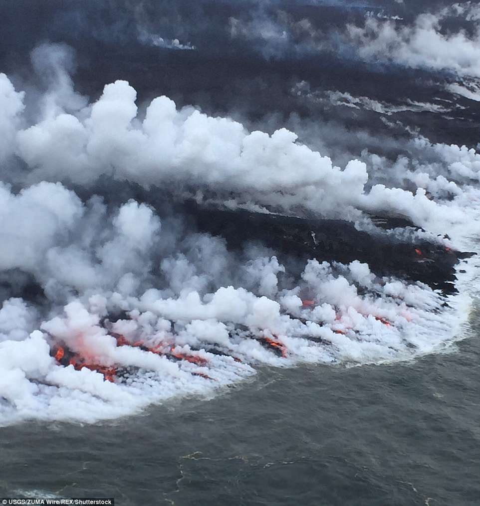The south side of the ocean entry, above, shows many small streams of lava and corresponding steam plumes spread along a fairly broad section of the southern part of the delta
