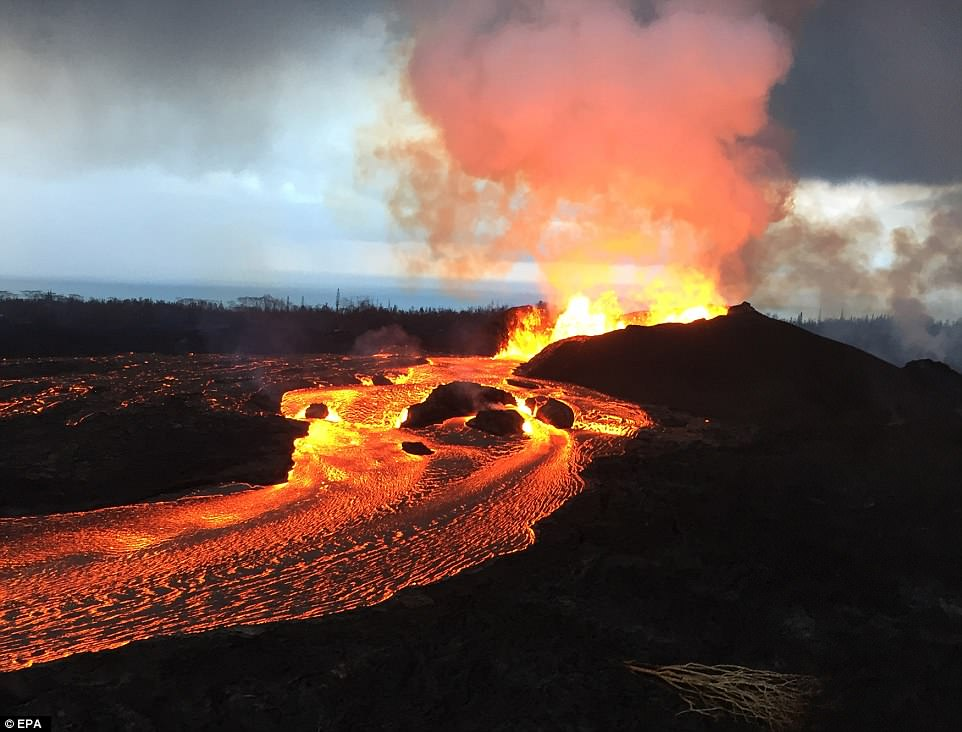 Kilauea volcano's fissure 8 fountains reportedly reached heights up to 160 feet (48 meters) overnight on June 12. Lava fragments falling from the fountains are building a cinder-and-spatter cone around the vent