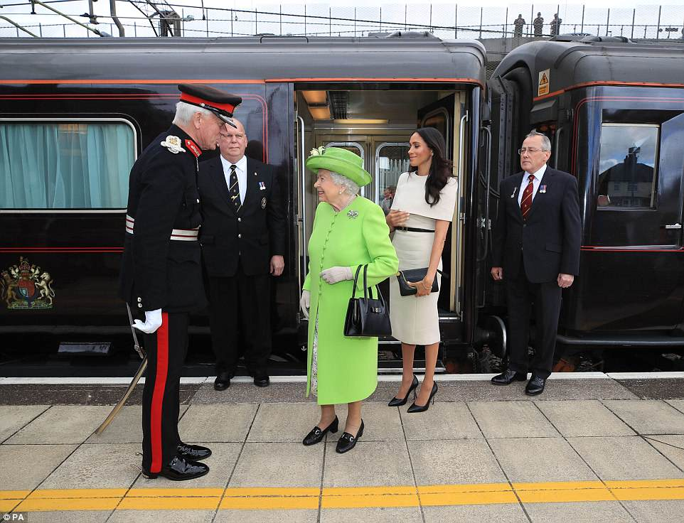Her Majesty looked vibrant as ever in lime green, while Meghan kept it simple in a cream dress teamed with black heels