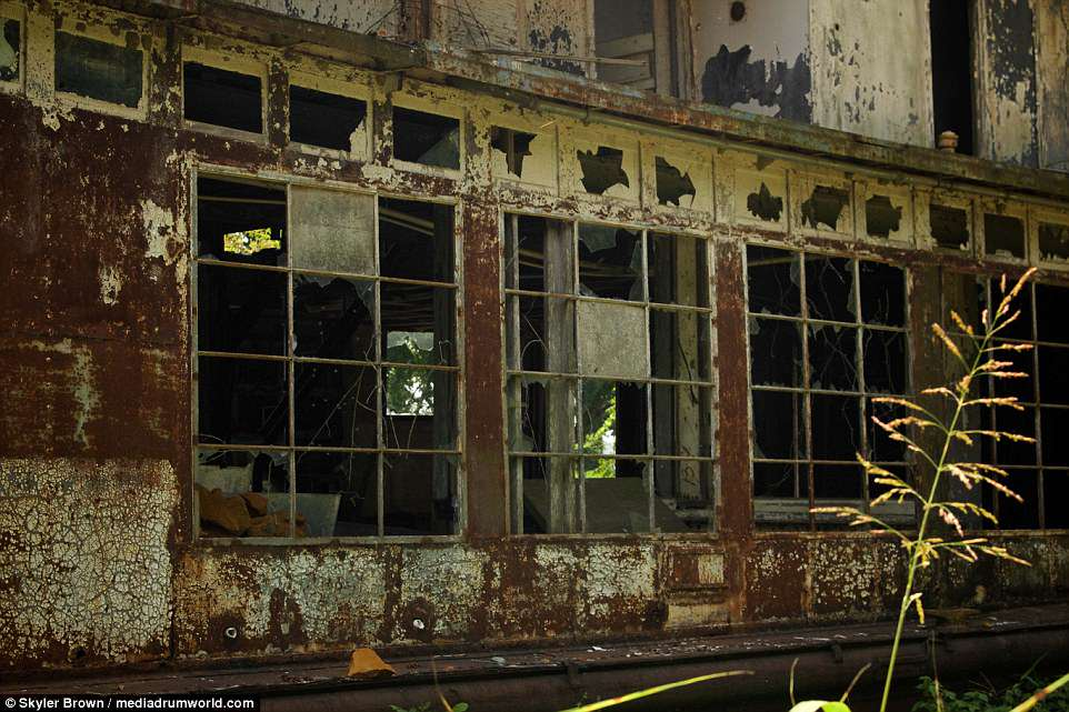 A severely rusted exterior, fire-gutted interior, debris-filled floors and shattered windows belie the glamorous history of the former Mamie S. Barrett in these pictures, snapped by artist and photographer Skyler Brown