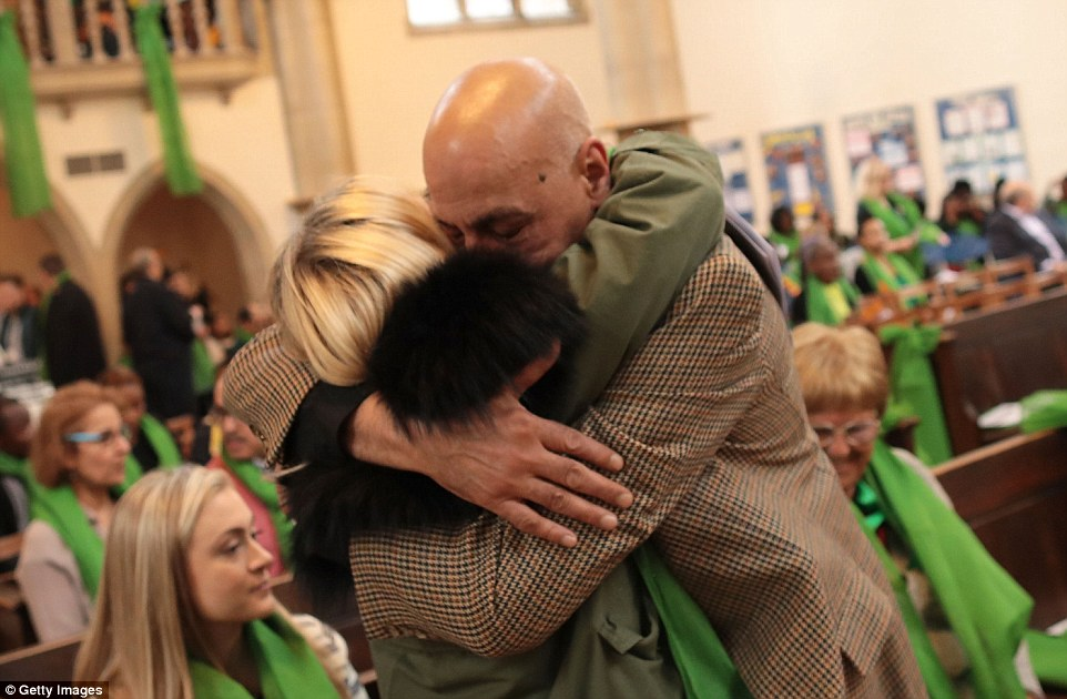 The congregation all wore green - which has become symbolic of the fight survivors have faced since the blaze on June 14 2017