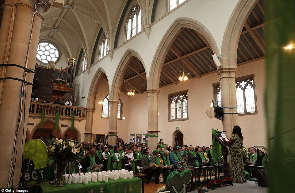 The congregation listen during the memorial service this morning at St Helen's Church in North Kensington, West London