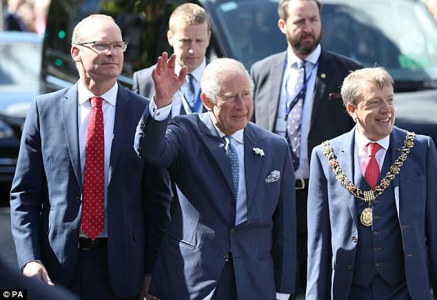 Charles waved to crowds of well-wishers who gathered at the English Market this morning