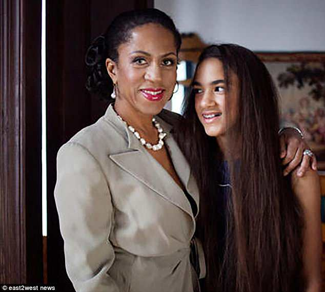 Journalist and TV presenter Yelena Khanga (pictured with her daughter) accused Pletnyova of making 'immoral' comments about mixed-race children