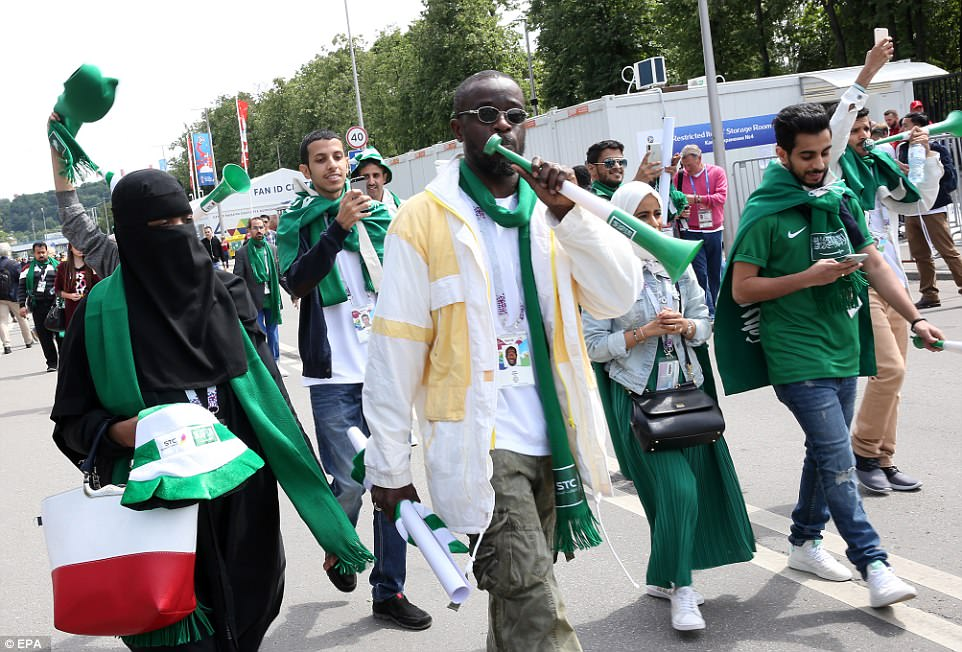 Saudi Arabia fans make their way to the Luzhniki Stadium as they prepare to start their campaign against hosts Russia