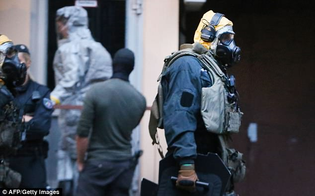 A plot to carry out a biological attack using ricin has been foiled in Germany, officials say. Police are pictured in special protective clothes at a flat in Cologne earlier this week