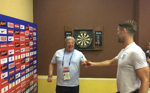 Sale takes on England defender Gary Cahill in a darts match at the team's World Cup base in Repino, near Saint Petersburg