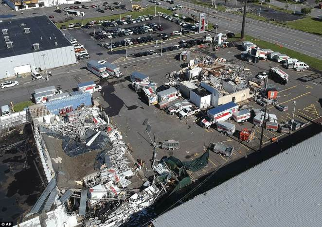 A parking lot of U-Haul trucks was destroyed in the tornado, with many of the vehicles flipped over and smashed in the storm