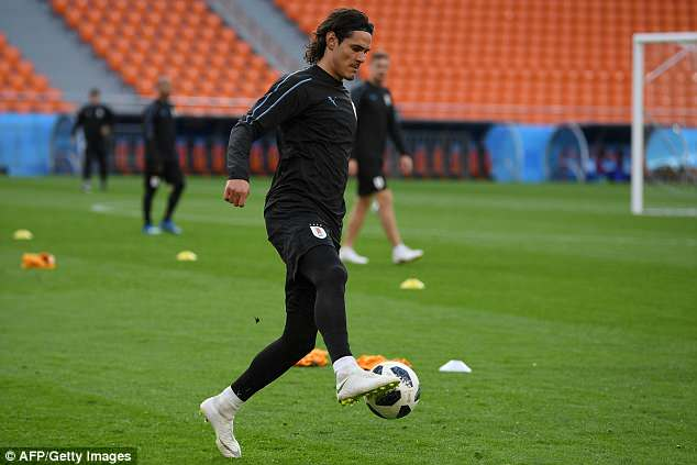 Cavani takes part in a training drill as the Uruguay team get put through their paces