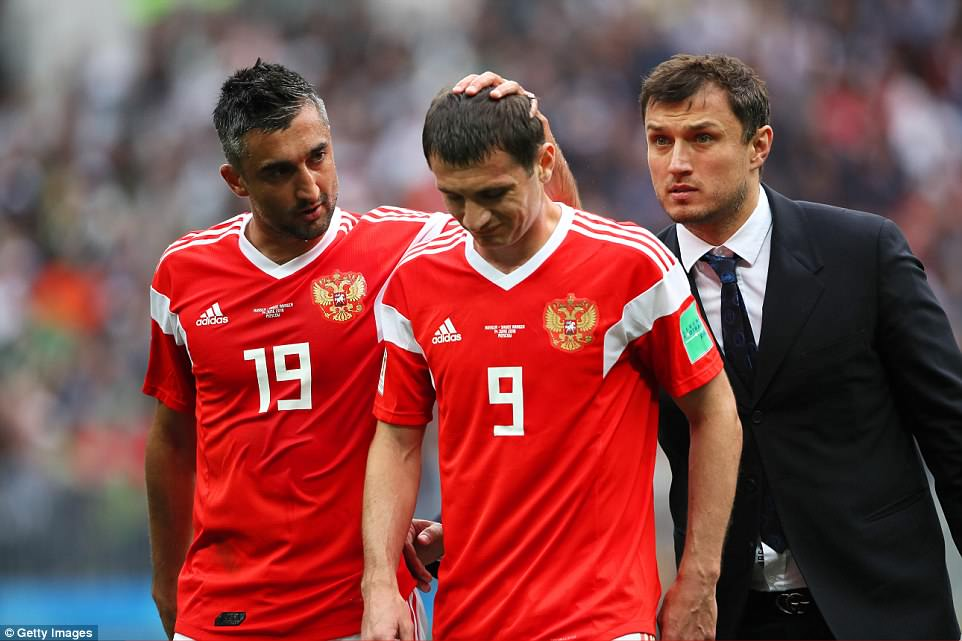 Dzagoev was consoled by his team-mateAleksandr Samedov as he trudged off with his tournament hopes now in tatters