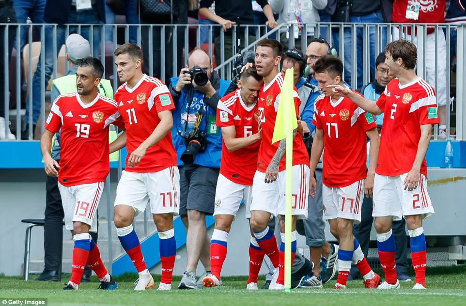 Russia's No 6 was promptly mobbed by his team-mates after doubling their advantage just before half-time