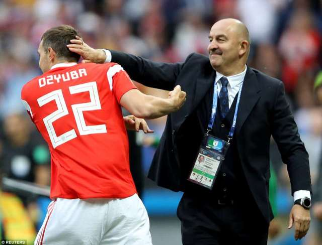 Dzyuba andCherchesov, who have had their differences in the past, embrace in celebration of the former's goal