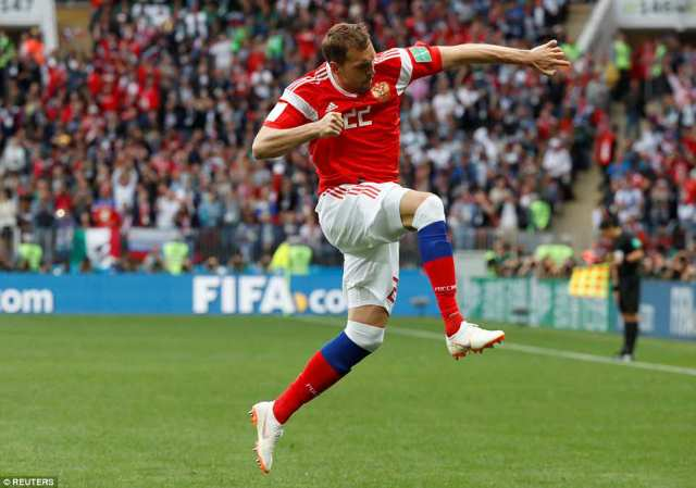 The towering striker punches the air with delight after extending his side's lead in the Russia capital