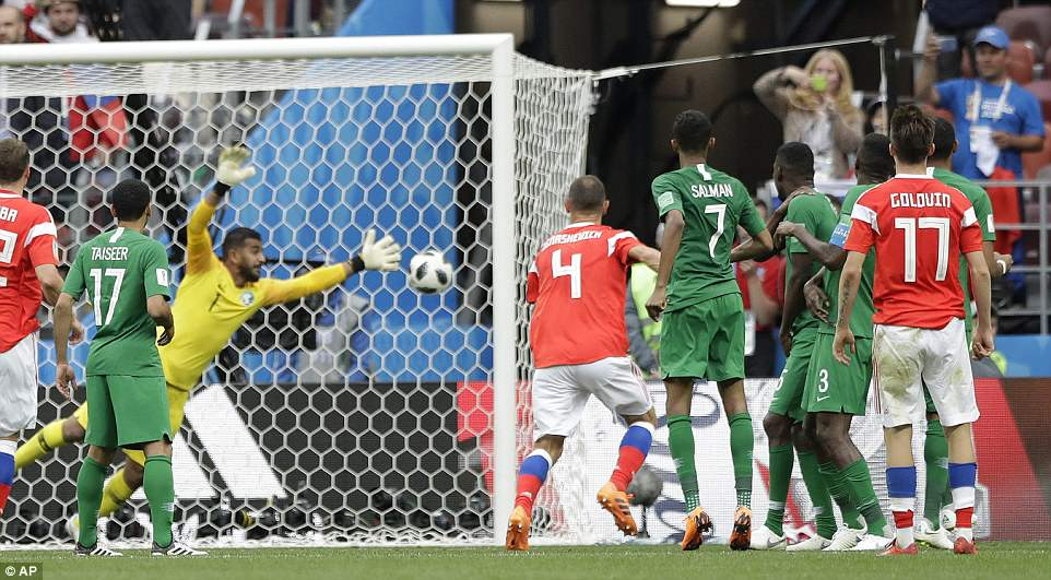The 22-year-old watches on as his effort curls up and over the wall before hitting the back of the net