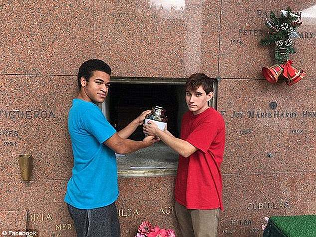 Zachary and Nikolas are pictured above interring their mother's ashes after her death in November 2017, just months before the school shooting