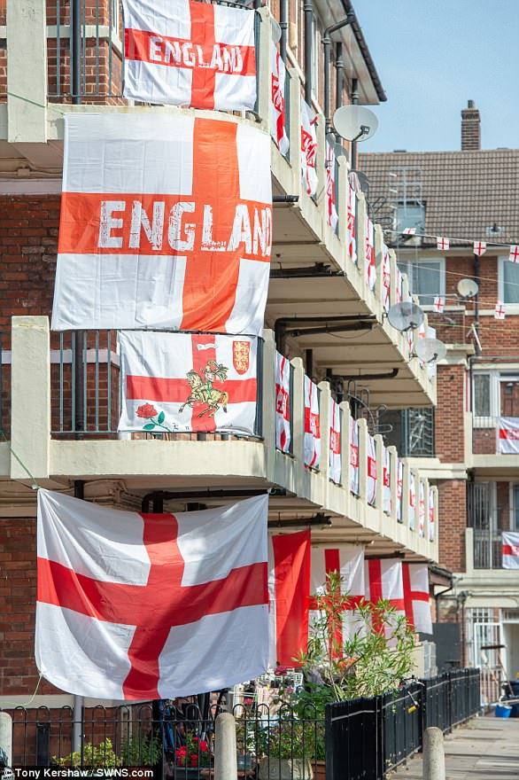 Hundreds of flags line the balconies and fences of the estate, where residents have previously gathered to watch important World Cup matches together