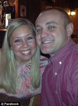 Hathaway is seen (left) with her husband, 34-year-old wrestling coach Joe Hathaway. She was fired in May after an investigation by the school and was arrested this month