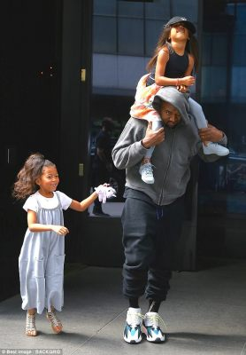 Best friends:Rapper Kanye grinned at the cameras as he walked, holding tight to his precious girl, while North's best friend Ryan Romulus hung onto Kanye's sweater