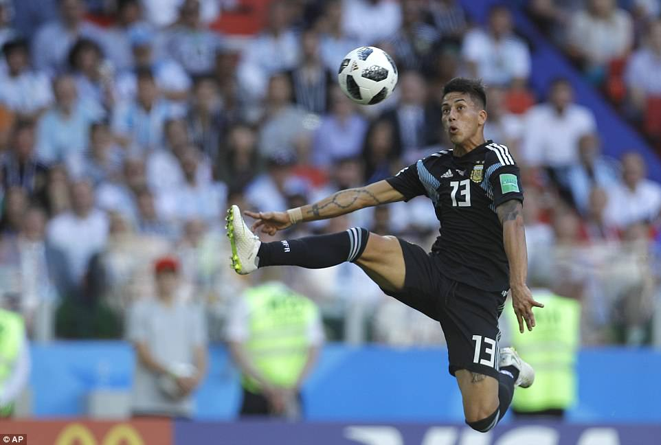 Argentina's Maximiliano Meza, a 26-year-old midfielder with Independiente, jumps high in an attempt to control the ball