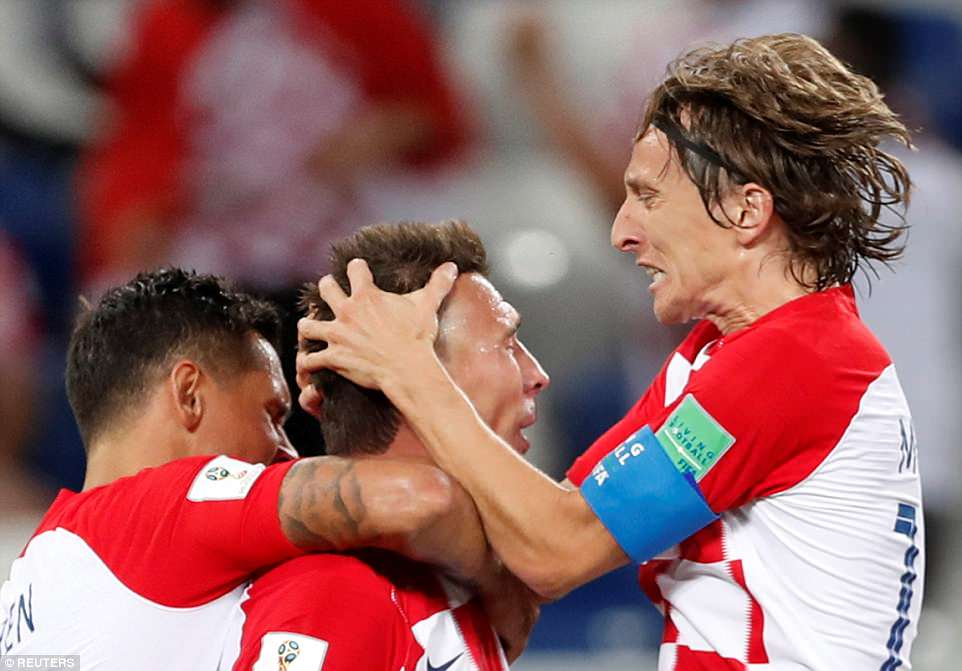 Real Madrid midfielder Modric (right) lead by example during the goal celebrations as the Croatia captain grabbedMandzukic