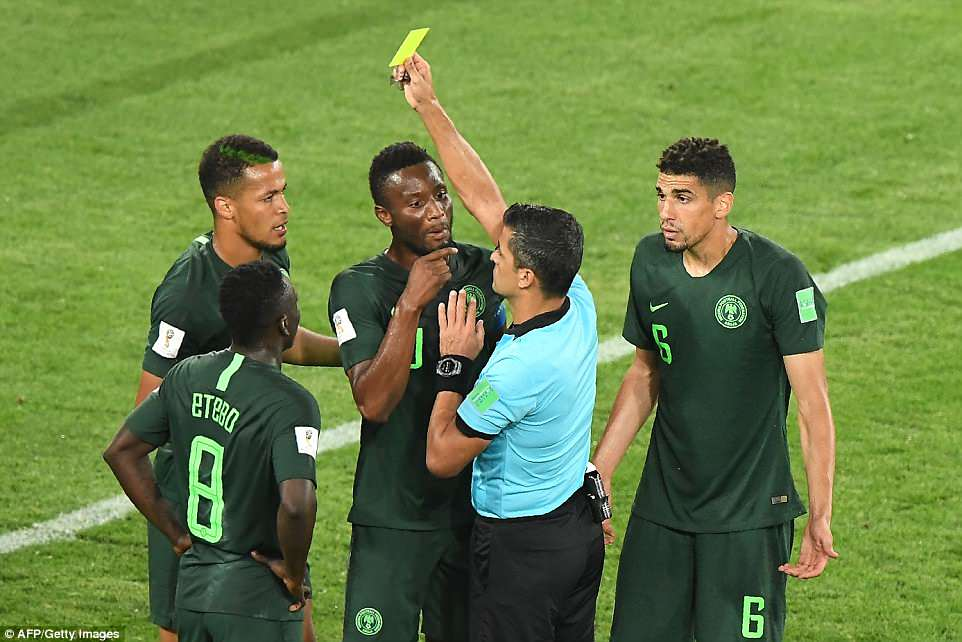 Nigeria protested against the award of the penalty butreferee Sandro Ricci stood firm and issued Troost-Ekong a yellow card