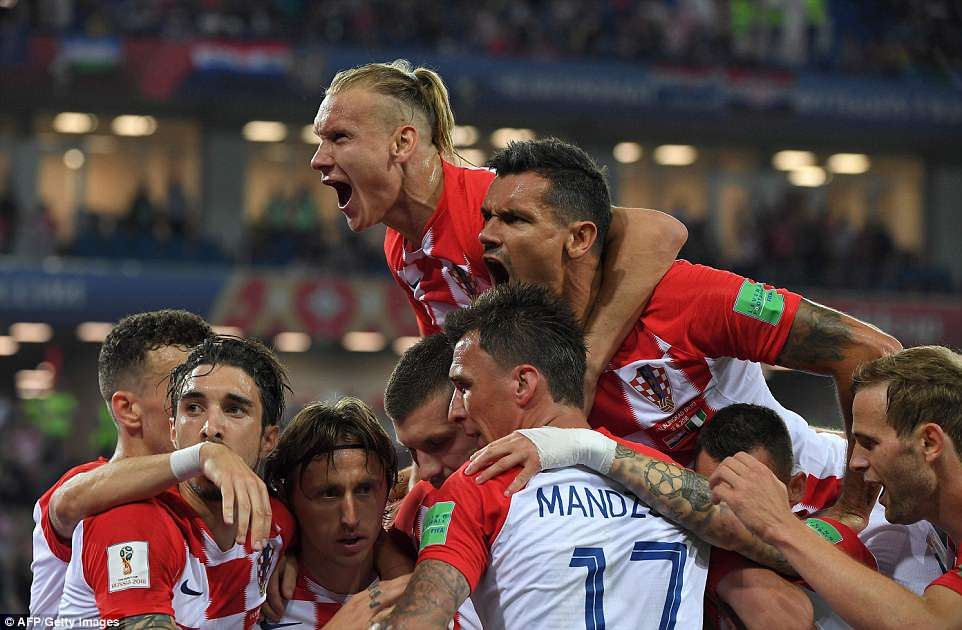 Modric was surrounded by his team-mates as Croatia's players celebrated their second goal in front of the fans inKaliningrad