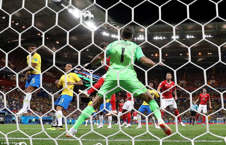 A view from behind the Brazil goal as Zuber heads the ball flying towards net as everyone else on the pitch watches on