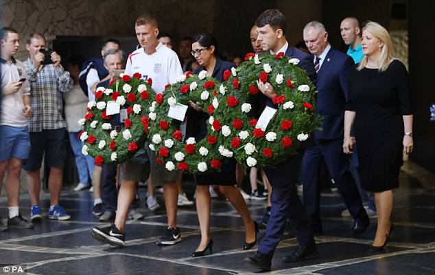 England fan James Lockett, (left) alongside chairman of the FA Greg Clarke (second from right) and British Deputy Ambassador, Lindsay Skoll(far right) attend the wreath laying at the Eternal Flame Monument at Mamayev Kurgan in Volgograd, Russia