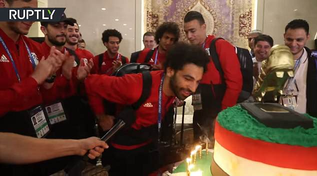 After singing 'happy birthday' with his team, Salah proceeds to blow out a few of the candles