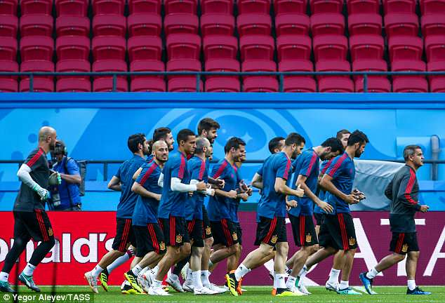 The Spain players go for a light job around the pitch ahead of Wednesday's group match