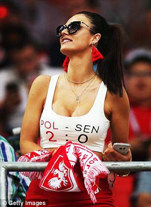 A Poland fan in the stands as the team took on Senegal